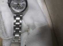 ساعة فضية للنساء