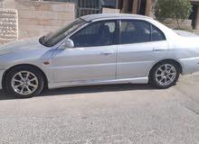 نوع السيارة ميتسوبيشي مراج 2000