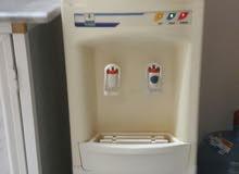 كولر (براد  مياه) كوري الصنغ 110 فولت مع 2 قاروره مياه