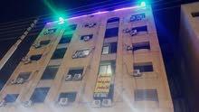 مشروع استثماري شقق فندقية للضمان علي الشارع رئيسي أبو نصير