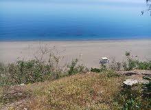 قطعة أرضية محفظة للبيع على البحر مباشرة في شمال المغرب بي أوشتام تطوان