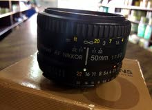 عدسة نيكون 50mm بحالة جديدة لتواصل رن ع رقم 0910400185