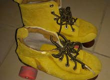 yellow skating shoes