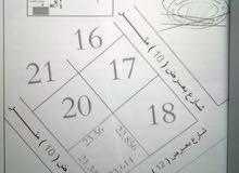 ارض 521م على شارعين ش المطبات بمنطقة أم مبروكة