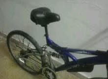دراجة ايطاليا شبه جديده زرقاء للبيع او التبديل بتلفون