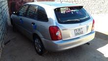 مازدا 323 2003
