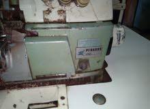 ماكينة عراوي brother812  وماكينة سرفلة 3 فتلة بيجاسوس l52