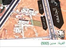 دونم ارض على طريق جامعة مؤته الباب الشمالي قرب دوار الطياره