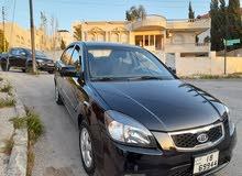 كيا ريو لون اسود ملوكي موديل 2011 محرك 1600 جير اتومتيك بحالة الشركة قطعت مسافة
