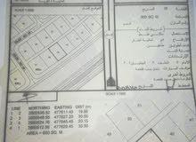 أرضين سكني شبك على الشارع العام  الفليج ولاية صحم