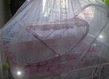 سرير بيبي 2×1 مع ناموسية لكل سرير وقطعة لغيار البيبي