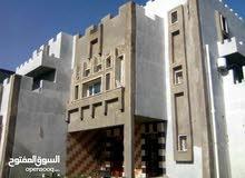 منزل دورين وملحق للبيع تاجوراء طريق المصانع داخل المخطط بالقرب من مدرسة الشحمات