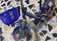 دراجة هوائية  للاطفال للبيع او المراوس بدراجة اكبر