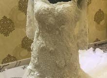 فستان زفاف ملكي للبيع أو الايجار بسعر خيالي