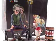 joker statue with Harley Quinn