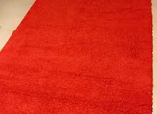 سجادة حمراء من غير رسوم من هوم سنتر للبيع باعلى سعر