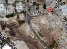 ارض للبيع ضاحية الرشيد مقابل الكلية العلمية الاسلامية مساحة 788 متر