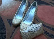 حذاء وشنطه للبدله الكبيره او للبدله الصغيره