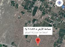 أرض في العقده 4 من المالك مباشر قريب من الخزان ماي حكومي و قريب من الشارع الخدما