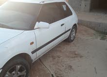 For sale Mazda 323 car in Gharyan