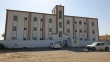 مبنى سكني للإيجار بمنطقة الخويرية بصحار