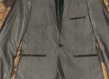 جاكيت بدلة رمادي اللون انيق للبيع