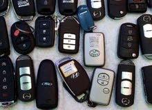 مفاتيح ولارمات أصلية للسيارات ونسخ واستخراج ريموت السيارات و أبواب القراجات