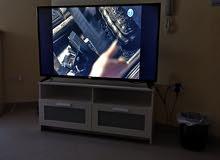 تلفاز مع خزانته