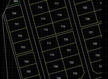 ارض سكنية ركنية في طاقة مربع ( ك) رقمها 715