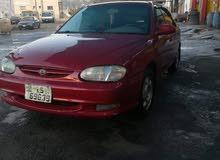 سيارة كيا 2 لون خمري