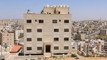 شقة _شبه ارضي مع  تراس +مدخل مستقل _ في الجبيهة ((بالقرب من الكلية العمليه الاسلاميه))