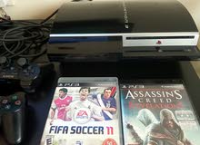 PS3 fat with 2 controller and 2 games