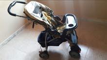 عربة اطفال بحالة جيدة نوع ماما لاف