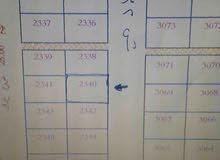 أرض 864م مخطط ولي العهد واحد على شارع 32 تجاري