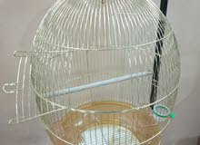 Golden cage with black hanger stand قفص