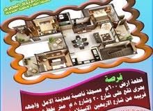 قطعة ارض 600م ناصية بمدينة الامل  واجهه بحرى