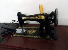ماكينة خياطة سنجر بالقاعدة الحديد .