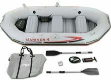 دنقي - قارب مطاطي مع ماكينه بنزين ومظله