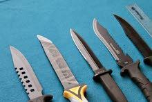 سكين متعددة الاستعمالات شكل مميز مع الغمد
