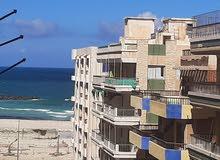 لعشاق التميز امتلك بالتقسيط شقة سادس صف من البحر في شاطئ النخيل