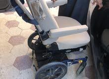 كرسي كهربائي يركب على سيارات