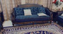 Green sofa, blue sofa and coffee table
