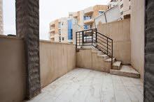 شقة شبه أرضي 130 مترمربع مع ترس و مدخل منفصل في الجبيهة