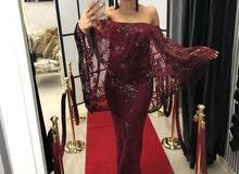 فستان سهرة فخم كتير  وراقي لون الخمري بس