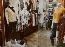 ديكور محل ملابس رجالي خشب للبيع للتواصل ع الرقم 07713142322