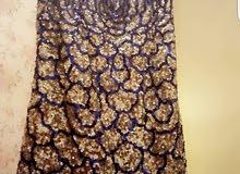 فستان  سهرة لون ابيض وفضي وازرق ملبوس مرة وحدة فقط للبيع ويلبس من 38/44
