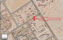 قطعة ارض مميزة على ناصية ببرج العرب