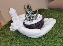 palm hand Buddha pot holder