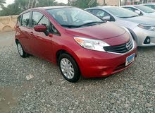 Red Nissan Versa 2015 for sale
