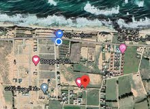 قطعة ارض358م واجهتين على البحر خلف قرية العطايا البعد عن حرم الشط 500م